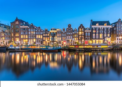 The Singel is a canal in Amsterdam which encircled the city in the Middle Ages. This famous part of the canal has spectacular houses and houseboats.