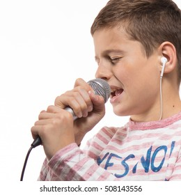 singer brunette teenager boy in a pink jumper with a microphone on a white background