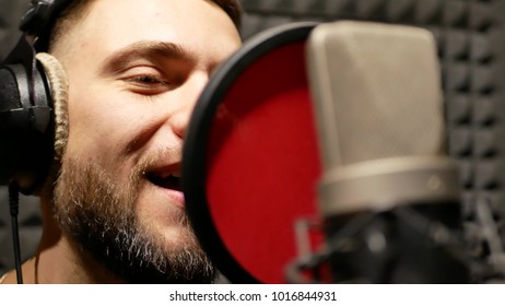 The singer man emotionally sing song in the recording studio