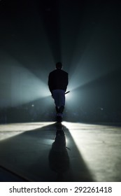 A singer man silhouette on stage