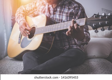 singer playing guitar on bed, concept of recreation.