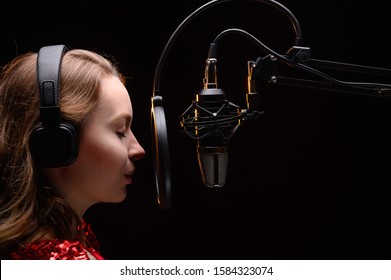 Singer or radio host blogger working in a professional studio. Recording a soundtrack, album, working with a label.