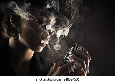 singer with retro microphone and cigarette smoke