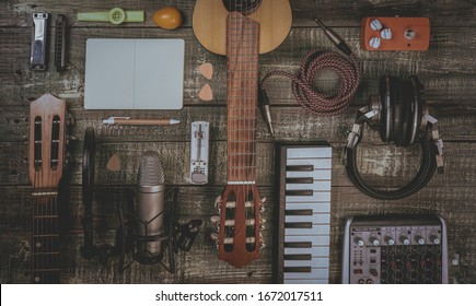 Singer, Songwriter, home recording and music producer flat lay concept. Ideal for home pages, diary, advertising, poster and so on. Lifestyle musician stuff on a vintage, aged, wooden table. Filtered
