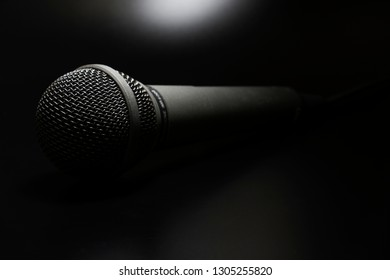 Singers microphone. Band instrument. Modern sound system equipment for a vocal performer. Mic isolated on black background.