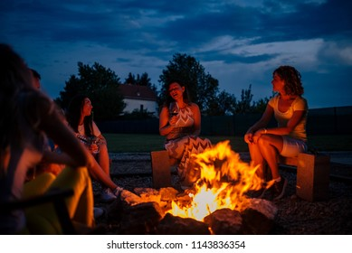 Singing around the bonfire.
