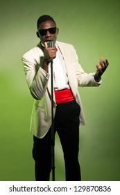 Singing black american man in suit wearing sunglasses. Vintage.