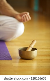 Singing Bowl in front of Man performing Yoga