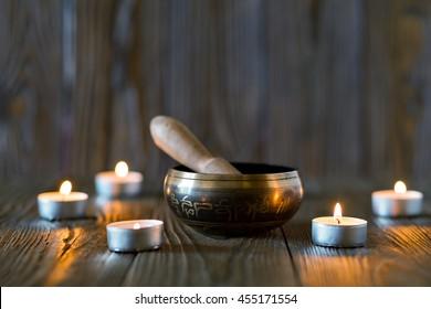 singing bowl on dark wooden background.