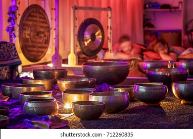 singing bowls lit by candlelight