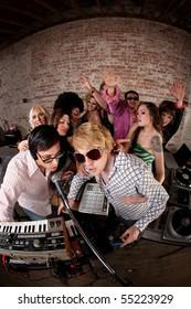 Singing DJsat a 1970s Disco Music Party