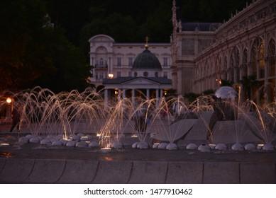 Singing fountain in Marienbad spa in Czech republic at night.