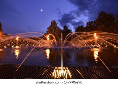 An singing fountain in spa city of Marienbad in Czech republic at night.