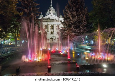 Singing fountain and State Opera Theater at night in Kosice Old Town on Hlavna or Main Square, Slovakia.