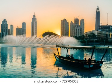 Singing fountains in Dubai. Dubai promenade singing fountains on the background of architecture. Dubai. In the summer of 2016.