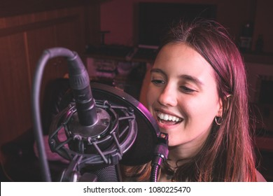 Singing girl singing with a microphone. Close-up of a woman singing
