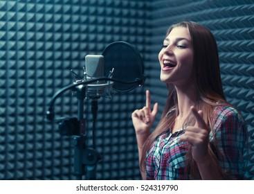 Singing girl in recording studio