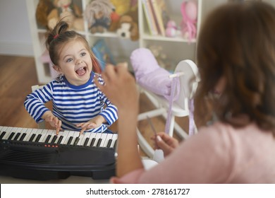 Singing and playing on musical instruments with my mommy
