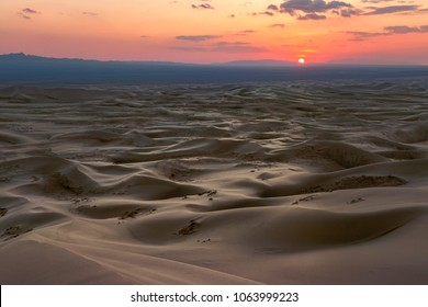 Singing Sand Dunes at Khongoryn Els in the Gobi Desert at Sunset. Setting Sun in Mongolia. Dramatic Light.
