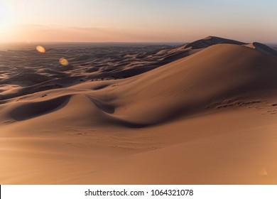 Singing Sand Dunes at Khongoryn Els in the Gobi Desert at Sunset. Setting Sun in Mongolia. Dramatic Light.