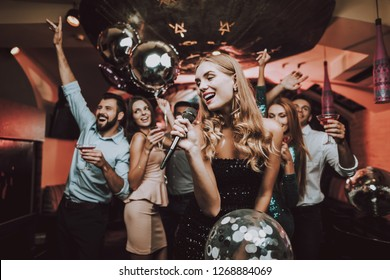 Singing Songs. Black Dress. Have Fun. Celebration. Background. Trendy Nightclub. Cheerful. Smiling Girl. Singing Songs. Handsome Men. Beautiful Girls. Friends at Karaoke Club. Karaoke Club.