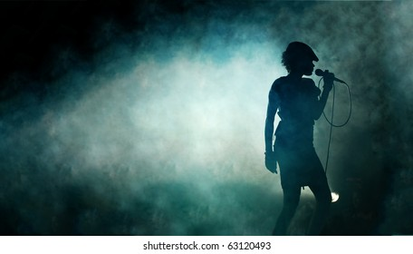 Singing woman silhouette with smoke background