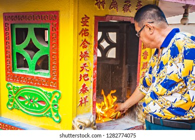 Singkawang, West Kalimantan, Indonesia : A prayer doing a ritual in a temple in Singkawang. Singkawang is a city in West Kalimantan that rich with Chinese culture (09/2015).