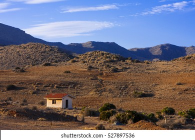 single abandoned house in the arid bushy desert of southern Spain, Andalusia