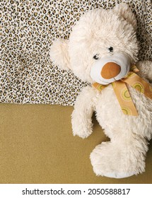 Single, alone, lonely teddy bear in bed is lying on the pillow and waiting for someone to sleep with him