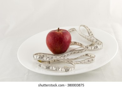 Single apple with a measuring tape