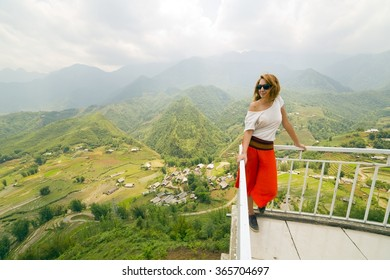 Single attractive woman on magnificent mountain view