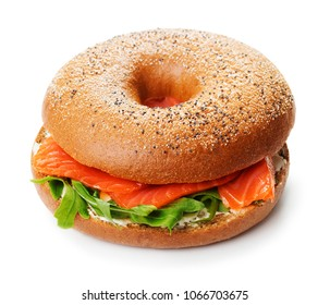 single bagel sandwich with cream cheese, salmon and arugula isoalated on white background