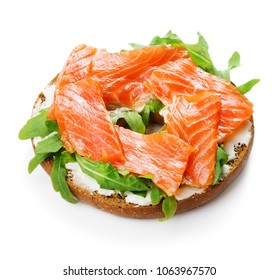 single bagel sandwich with salmon, cream cheese and arugula