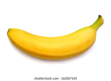 Single banana against white background