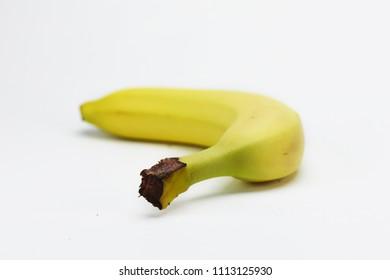 Single banana isolated on white background