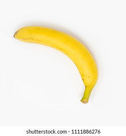 Single banana on a white background, isolated, view from top