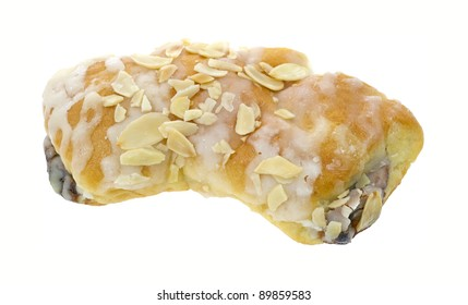 A single bear claw pastry with sliced almonds and confectionery sugar on a white background.
