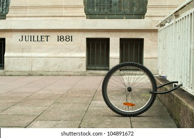 a single bicycle wheel on the street due to stealing