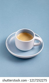 Single black coffee cup on blue background