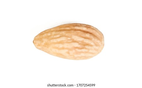 A single blanched almond seed isolated on white background. Diet food