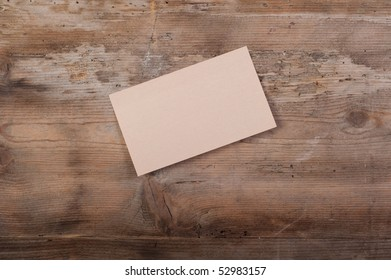 Single blank note paper on a old wooden background