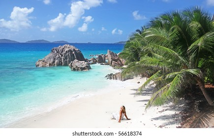 Single Blonde Sun worshiper with Beach all to herself in The Seychelles