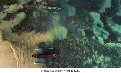 Single boat on clear water beach aerial photography from drone camera