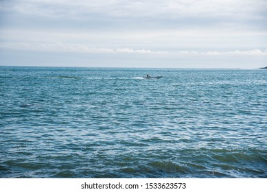 Single boat out at blue sea