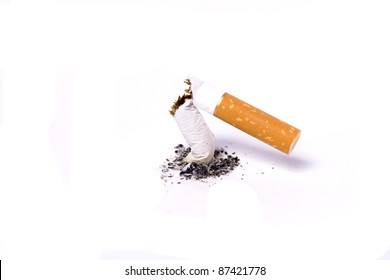 A single broken cigarette butts and ash  on white background