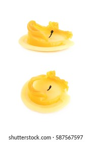 Single burned to the end yellow candle isolated over the white background, set of two different foreshortenings