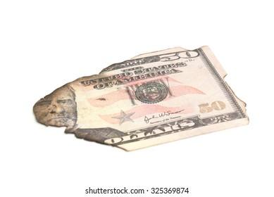 single burnt dollar banknote on white background closeup