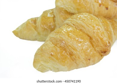 Single Butter Croissant isolated on white - clipping path included