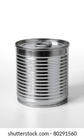 Single can of conserved food over white background