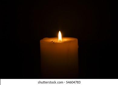 single candle on white background